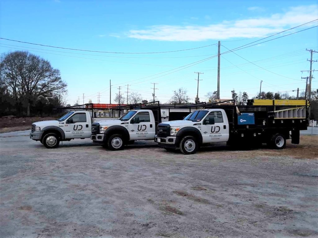 Piedmont and Greenville Garage Door Company Upstate Door Co photo of all trucks